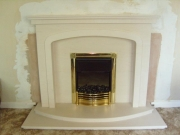 Dimplex Danesbury Electric Fire in Portuguese Limestone Fireplace with Lights, Ormskirk, Lancashire.