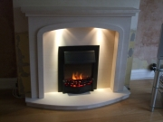 Dimplex Danesbury Electric Fire in Portuguese Limestone Fireplace with Lights, Tarleton, Preston, Lancashire