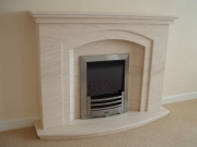 ​Gazco Glass Fronted Gas Fire in Portuguese Limestone Fireplace with Lights, Ainsdale, Southport, Merseyside