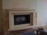 Hole-In-The-Wall Fireplace in Portuguese Limestone. Hesketh Bank, Preston, Lancashire