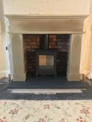 Stovax Sheraton with Sandstone Fireplace slate hearth and tiled brick chamber